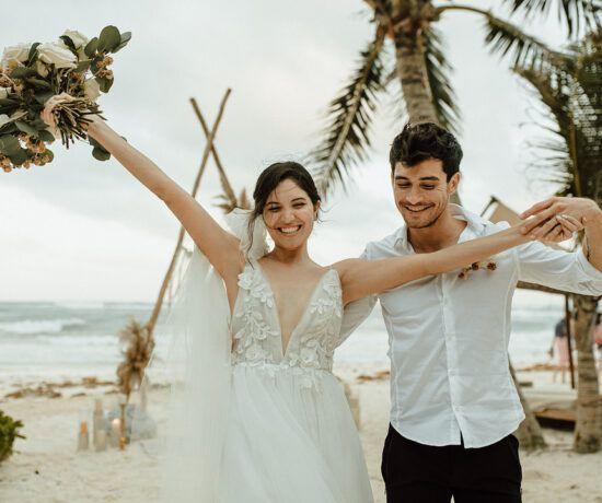 couple celebrating at elopement in tulum